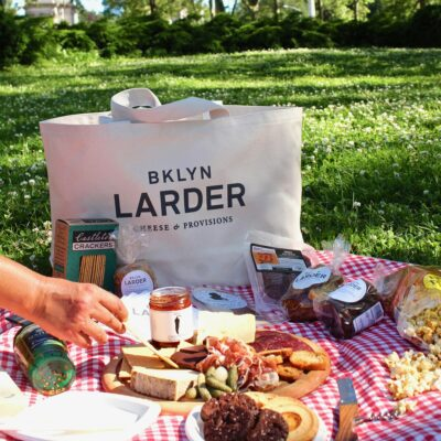 canvas tote bag and picnic spread in the park